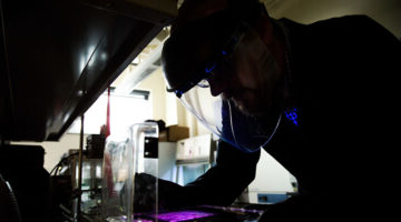 A male researcher working in a research lab.